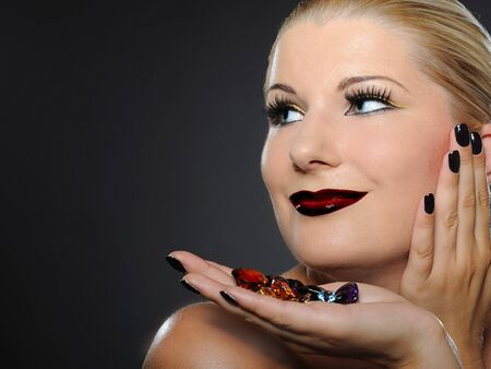 pretty woman face: Fall fashion makeup trend. pretty woman face with perfect lips and jewel stones