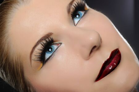 Fall fashion makeup trend. pretty woman face with bright make-up and purple lipstick Stock Photo - 7997602