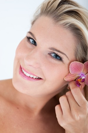 beautiful woman with healthy skin and orchid flower Stock Photo - 7997421