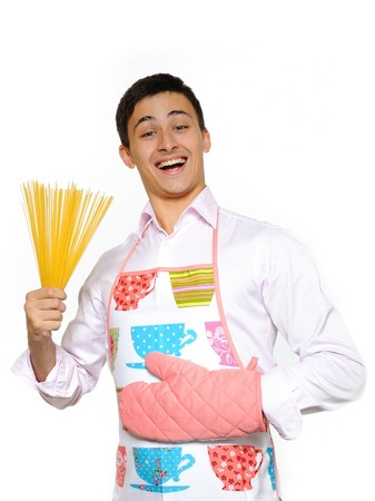 young happy cook with spagetti pasta. isolated on white background Stock Photo