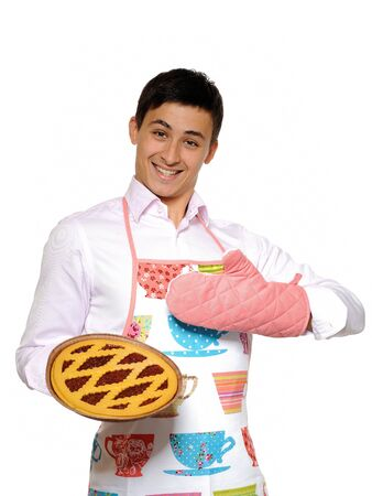 Cooking. Young man in apron baked tasty pie. isolated on white background Stock Photo