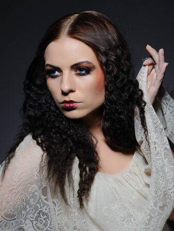Gothic female portrait with creative make-up and white pure skin photo