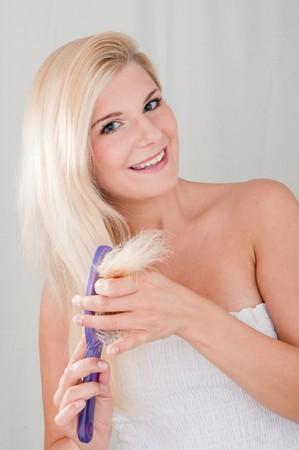 beautiful girl brushing her long healthy hair photo