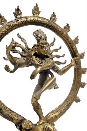 Statue of indian hindu god dancing Shiva Nataraja. fragment. isolated on white photo