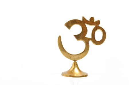 Figure of golden indian symbol aum. isolated on white background photo