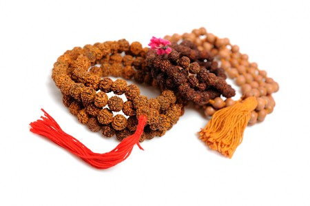 Traditional indian rosary for meditation - mala . isolated on white background Stock Photo - 8045289