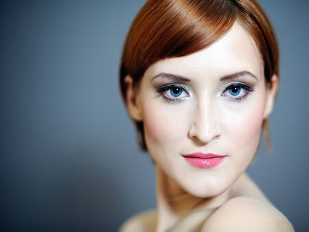 Portrait of pretty woman with pure healthy skin and natural make-up in brown tones photo
