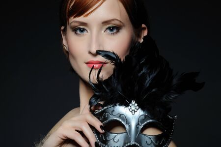 Beautiful woman with perfect party make-up in carnival mask Stock Photo - 8045371