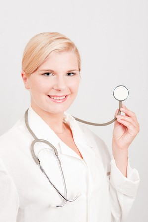 pretty female doctor with medical stethoscope Stock Photo - 8110154