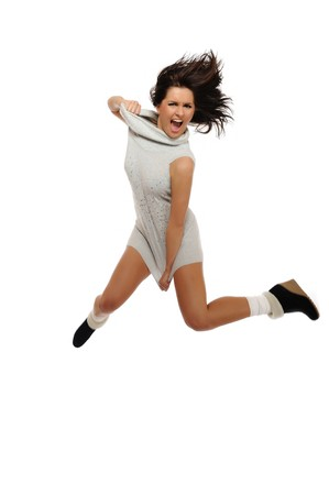 Dynamic beautiful wild winter woman jumping and screaming. isolated on white background Stock Photo - 8088656