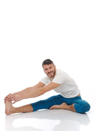 Handsome active man doing yoga fitness poses. isolated on white background Stock Photo - 8088677