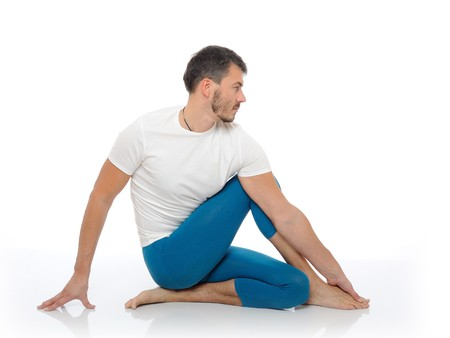 Handsome active man doing yoga fitness poses. isolated on white background