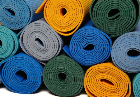many colorfull yoga mats as a background. isolated on white background Stock Photo - 8088917