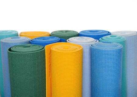 many colorfull yoga mats as a background. isolated on white background