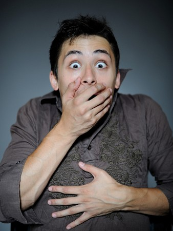 Expressions. Handsome young man feeling fear and shock  closing mouth with hands Stock Photo - 8157895