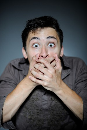 Expressions. Handsome man is terrified and feeling fear Stock Photo - 8157894