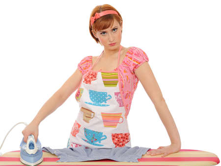 Beautiful angry house woman ironing. isolated on white background Stock Photo