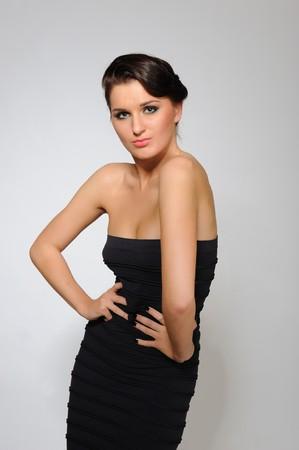 Beautiful woman in short elegant dress dancing. Stock fotó
