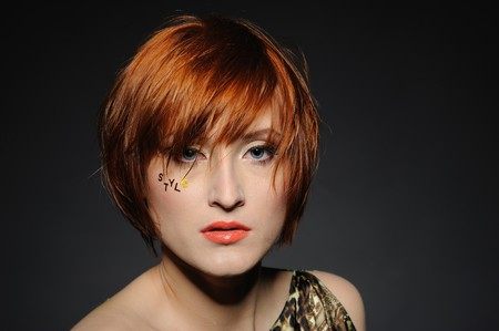 girl short hair: Beautiful red heaired woman portrait with fashion hairstyle and creative trendy make-up