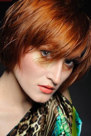 Beautiful red heaired woman portrait with fashion hairstyle and creative trendy make-up Stock Photo - 8244167