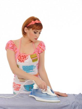 Beautiful house woman ironing mens shirt. isolated on white background photo