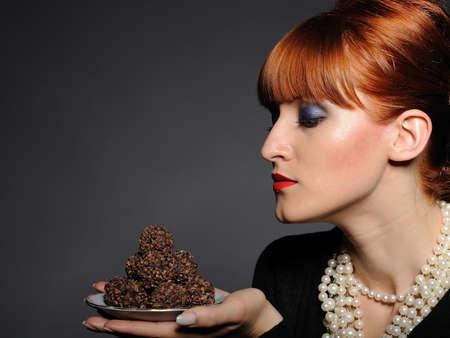 chocolate truffle: Beautiful elegant fashion woman with chocolate truffle sweets