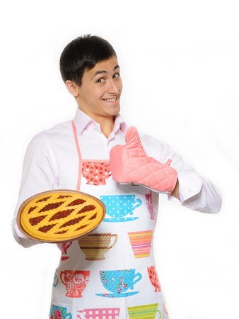 Young man in apron baked tasty pie. isolated on white background
