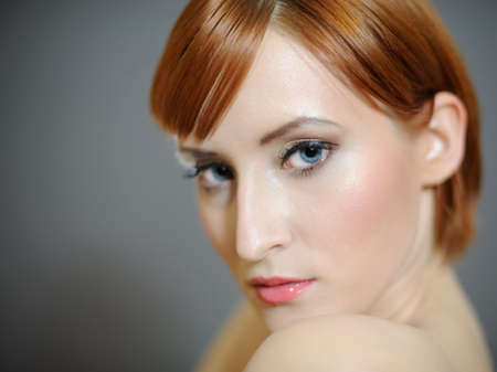 Portrait of pretty woman with pure healthy skin and retro make-up in brown tones photo