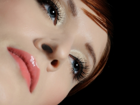 Beautiful macro shot of blue woman eyes with long lashes and make-up in brown tones photo