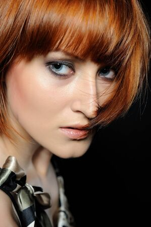 Beautiful red haired woman with fashion bob hairstyle and smoky make-up  photo