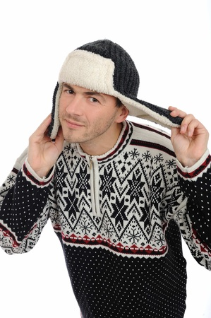 Funny winter man in warm hat and clothes listening. isolated on white background Stock Photo - 8328428