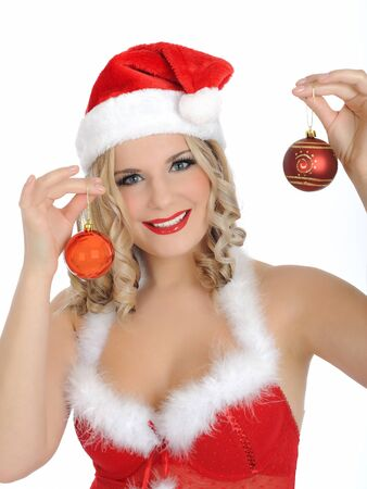 Beautiful sexy santa clause woman in party red clothes, hat and christmas tree decoration balls. isolated on white background photo