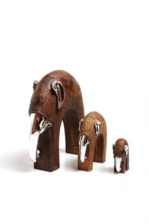Beautiful wooden statue of elephant family . isolated on white background photo