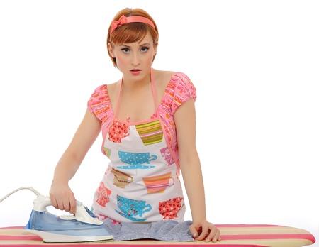 Beautiful house woman ironing mens shirt. isolated on white background Stock Photo - 8328366