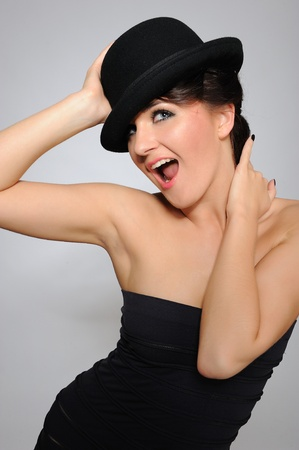 Beautiful pretty woman portrait in elegant dress and hat smiling photo