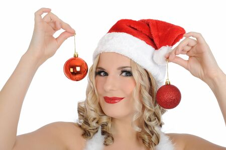 Beautiful sexy santa clause woman in party red clothes, hat and christmas tree decoration balls. isolated on white background Stock Photo - 8400127