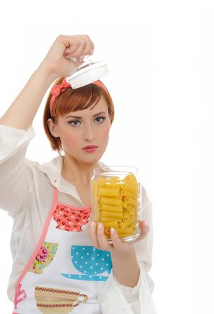 Beautiful cooking woman in apron with italian pasta. isolated on white background photo