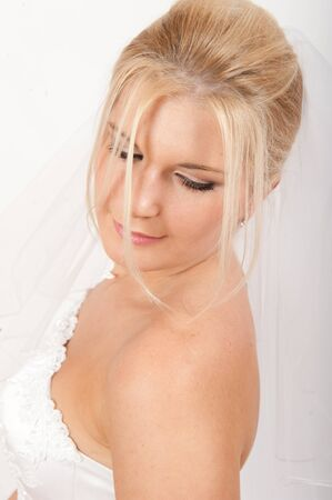 Beautiful bride in white wedding dress photo