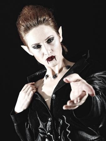 Portrait of a beautiful fashion vampire woman  photo