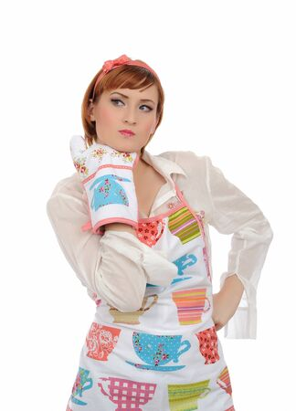 expressions. Beautiful cooking woman in apron and kitchen glove having problem. isolated on white background photo