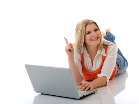 Young pretty girl networking on laptop computer in internet. isolated on white background Stock Photo - 8598640