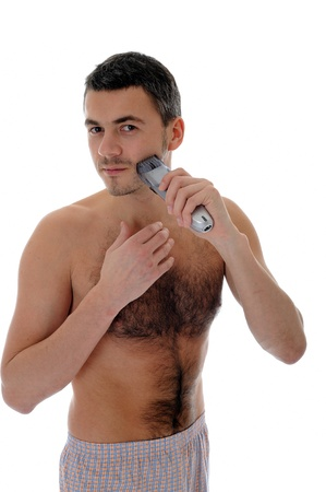 Young handsome man shaving in the morning . isolated on white background photo