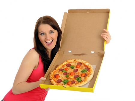 Pretty young casual woman with tasty pizza in delivery paper box.   solated on white background photo
