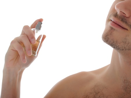 macro shot young male spray perfume on his skin. isolated on white background Stock Photo