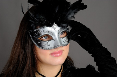 Beautiful sexy woman in party carnival mask . isolated on gray background photo