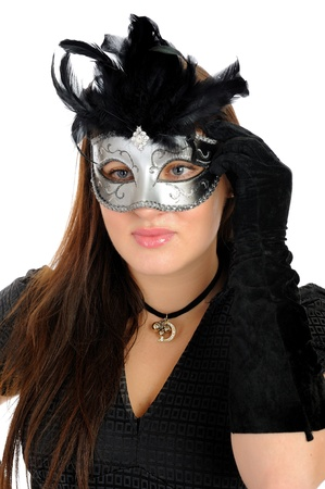 Beautiful brunette woman in black dress in party carnival mask . isolated on white background photo