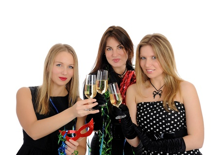 Group of three beautiful woman with glasses of champagne celebrating on party. isolated on white background photo