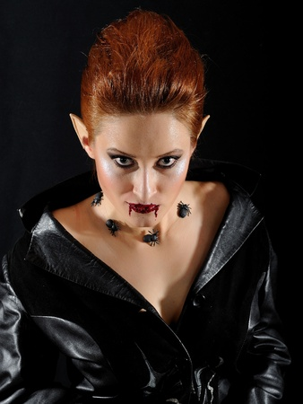 Terrible fashion vampire woman with spiders and blood Stock Photo - 8737778