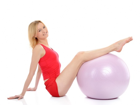 Pretty sporty fitness woman doing exercise with pilates ball. isolated over white photo