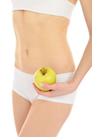 woman with beautiful body holding an apple near the slim waist. isolated on white background Stock Photo - 8737703